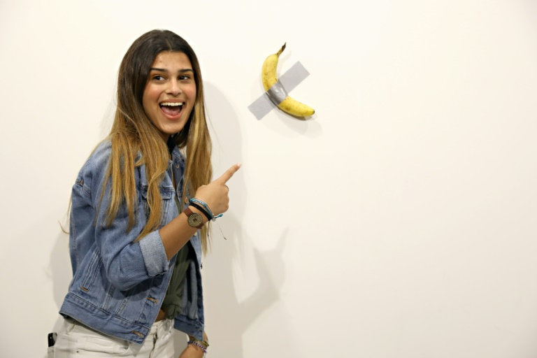 Man eats $120,000 piece of art - a banana taped to wall