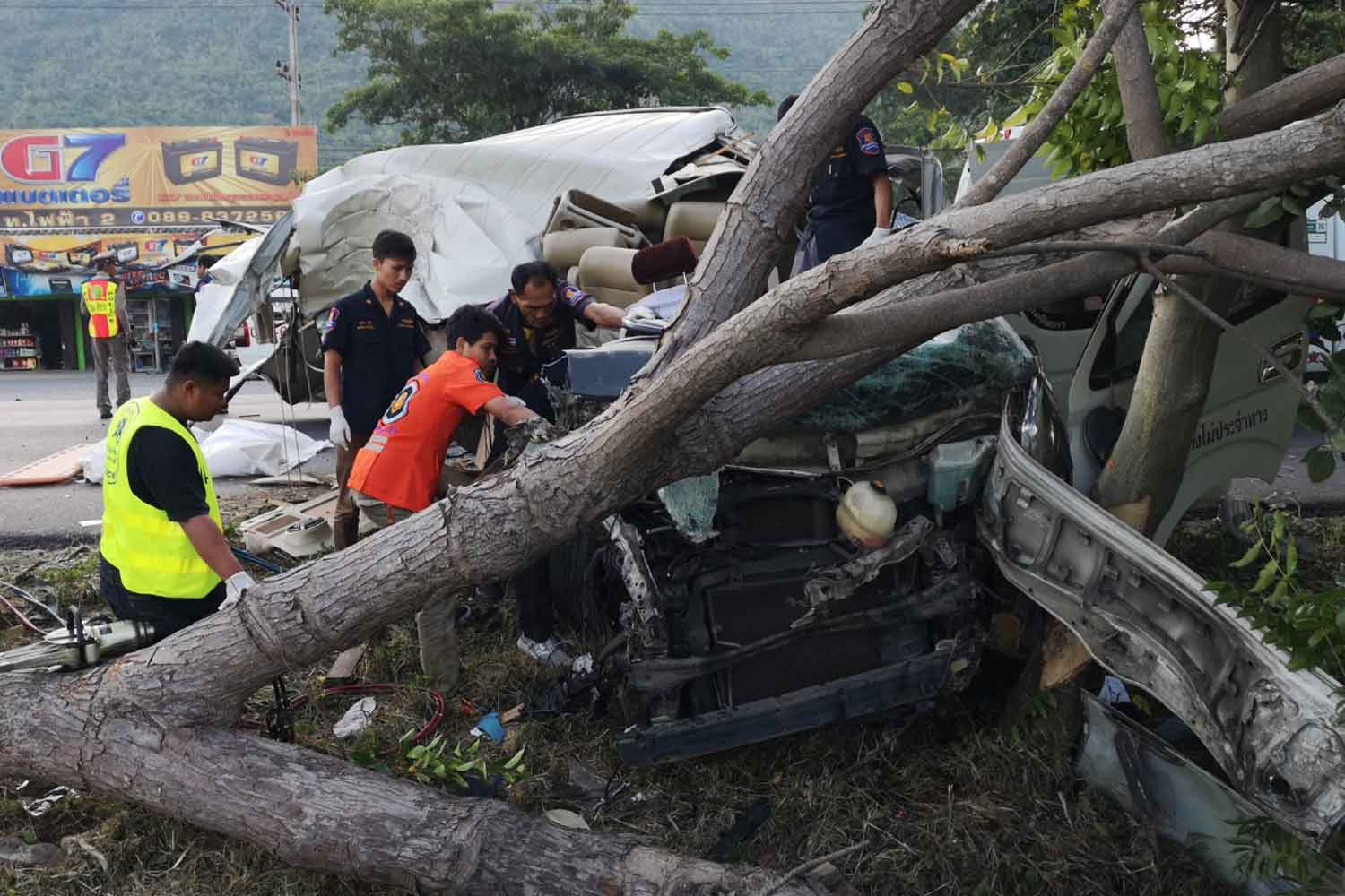 Rescue workers at the scene of the crash which claimed the life of the van driver and three passengers, in Muang district of Prachuap Khiri Khan, on Monday morning. (Photo by Chaiwat Satyam)