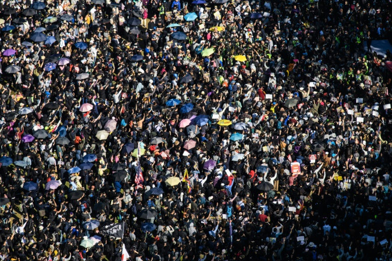 Hong Kong saw its largest mass rally in months on Sunday, with organisers estimating some 800,000 people turned out.