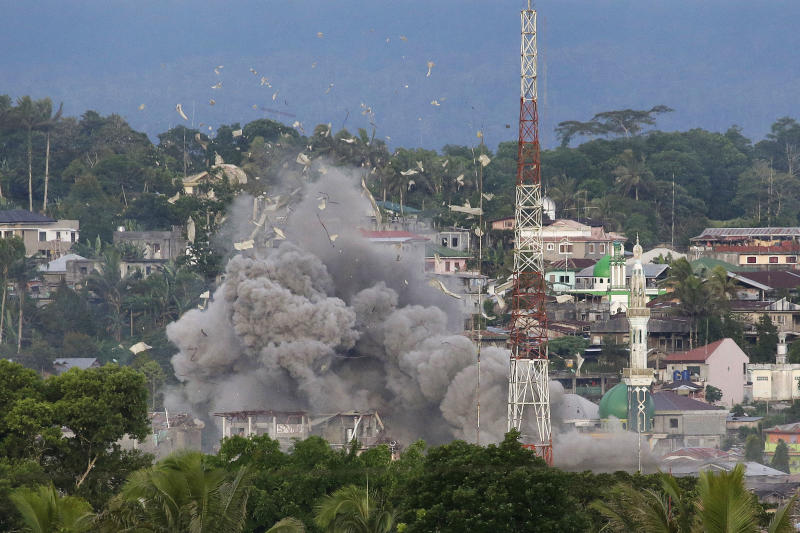 In this June 9, 2017, file photo, debris flies in the air as Philippine Air Force fighter jets bomb suspected locations of Muslim militants as fighting continues in Marawi city, southern Philippines. (AP)