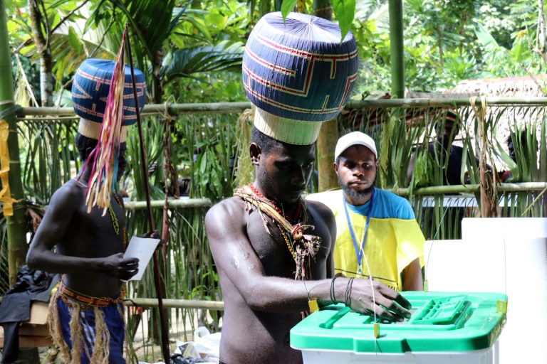 Young Upe men cast their votes in the Bougainville Referendum at the men's only polling station in Teau Bougainville, Papua New Guinea.