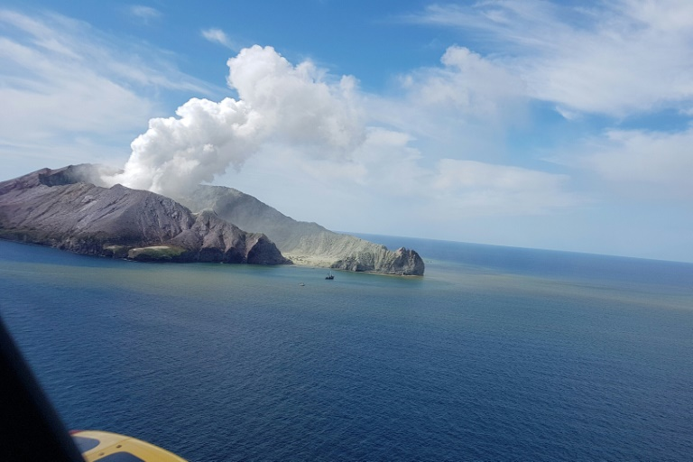 This handout photo taken on Dec 9, 2019 and released by the Auckland Rescue Helicopter Trust shows the view as a helicopter heads toward the smoldering White Island volcano off the coast of New Zealand's North Island.