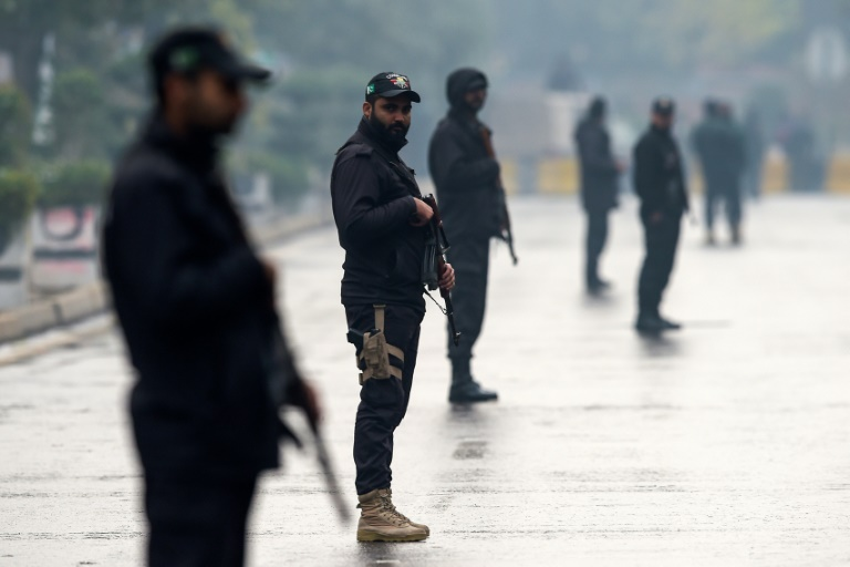 Security personnel stood guard near the stadium in Rawalpindi.