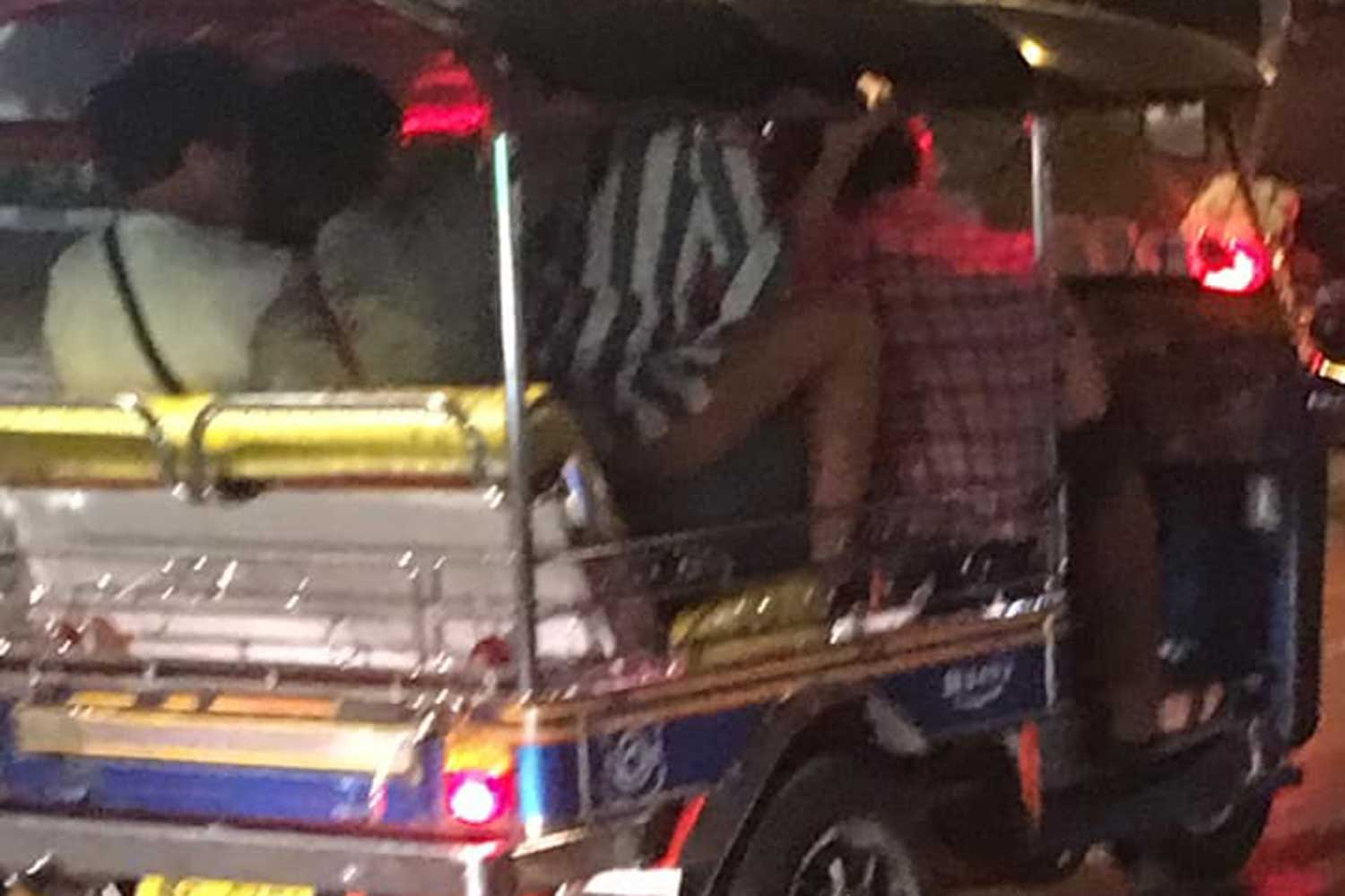 This woman seen sitting on the lap of a male passenger in a tuk-tuk on a Bangkok street and apparently having sex with him drew a storm of criticism online after the two video clips went viral. (Photo taken from Khun-Khachen Facebook page)