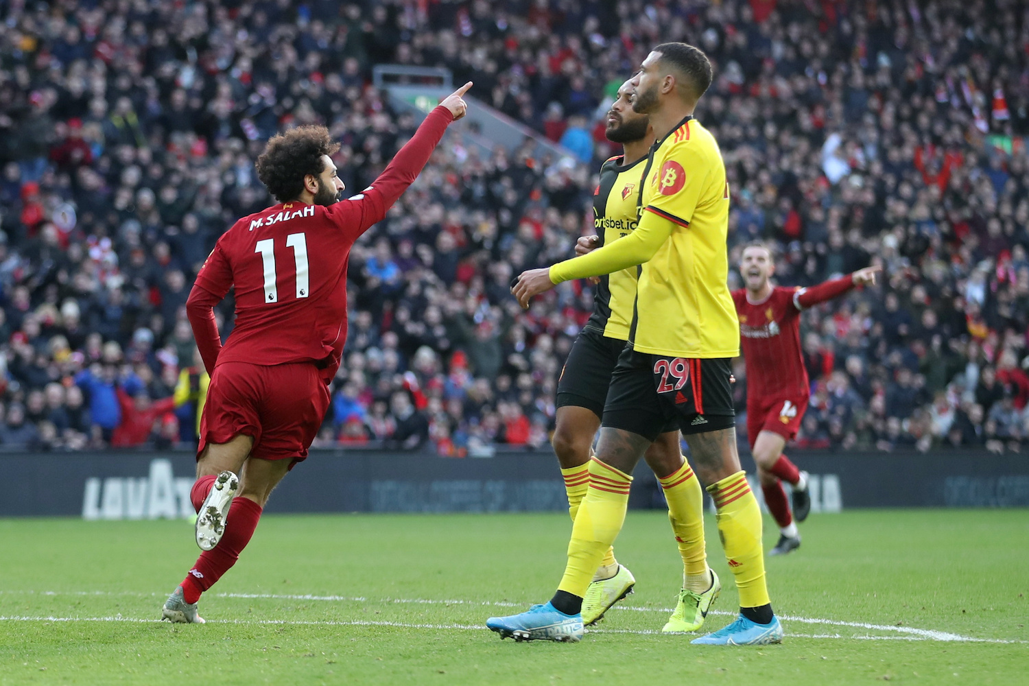 Mohamed Salah celebrates scoring Liverpool's first goal during their match against Watford at Anfield on Saturday. (Reuters Photo)