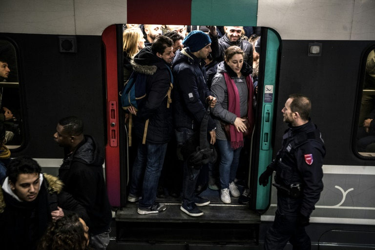 Security agents monitored packed suburban rail trains at the Gare du Nord station in Paris on Friday, during the ninth day of a public transport strike over pension overhauls.