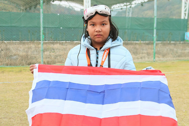 Wanraya Wannapong, 12, poses with a Thai flag after defending her drone racing crown in Ningbo, China, on Saturday. (World Air Sports Federation photo)