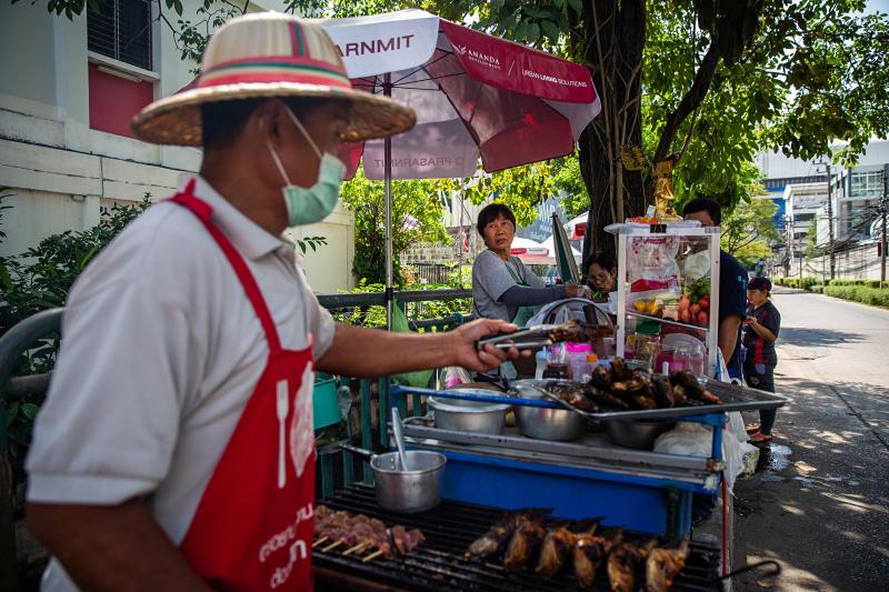 Somboon Chitmani, centre, who has been making green papaya salad in the streets ofBangkokfor 36 years, inBangkok, on Nov 19, 2019 (New York Times photo)