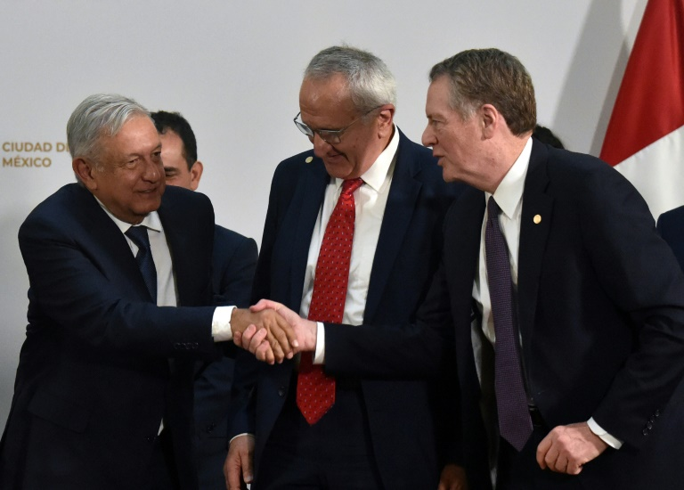 Mexican President Andres Manuel Lopez Obrador (left) shakes hands with US Trade Representative Robert Lighthizer as Mexico's Jesus Seade looks on at the trade pact signing on Tuesday.