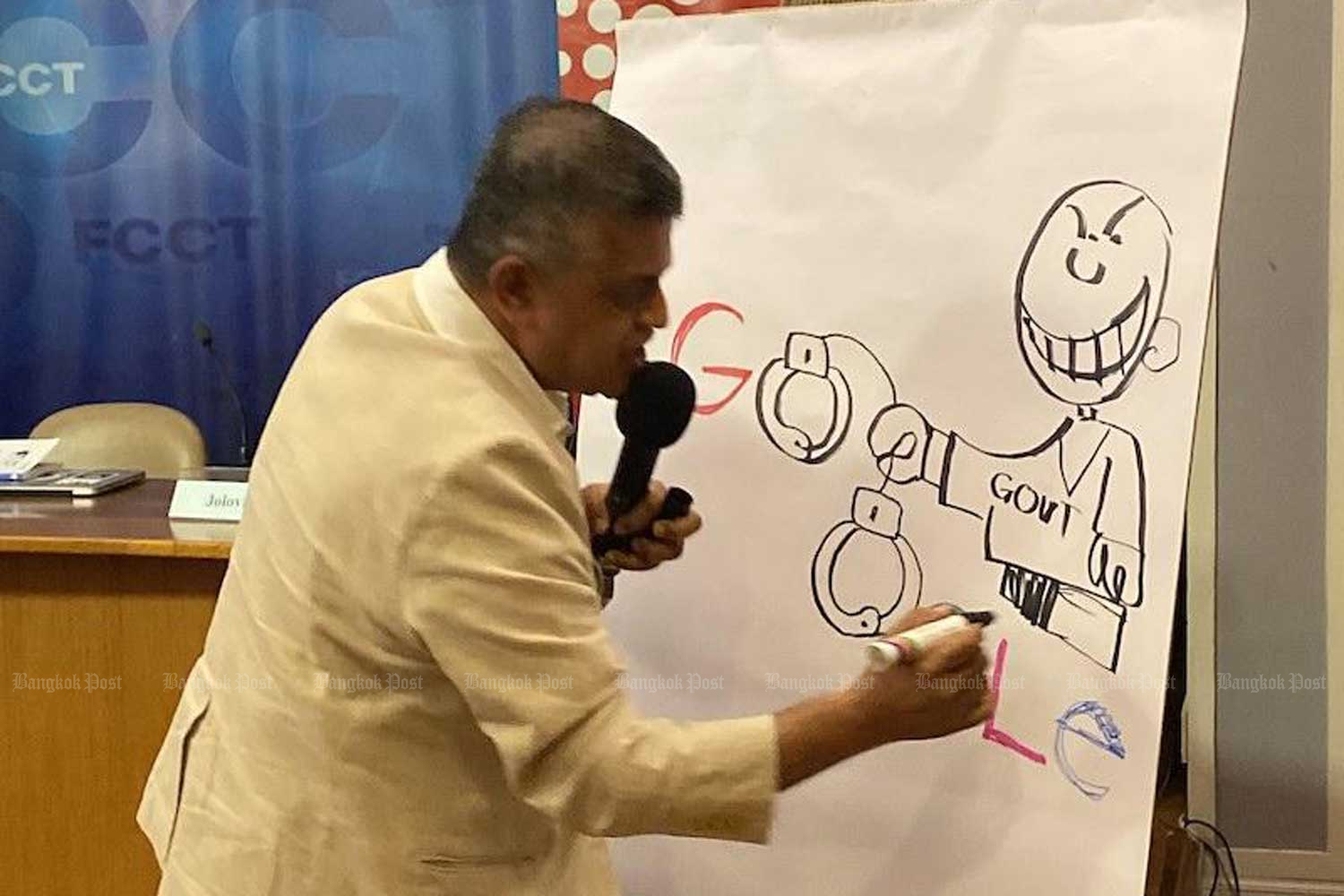 Malaysian cartoonist Zunar helps launch a report by the International Commission of Jurists at the Foreign Correspondents' Club of Thailand. (Photo by Osama Motiwala/ICJ))
