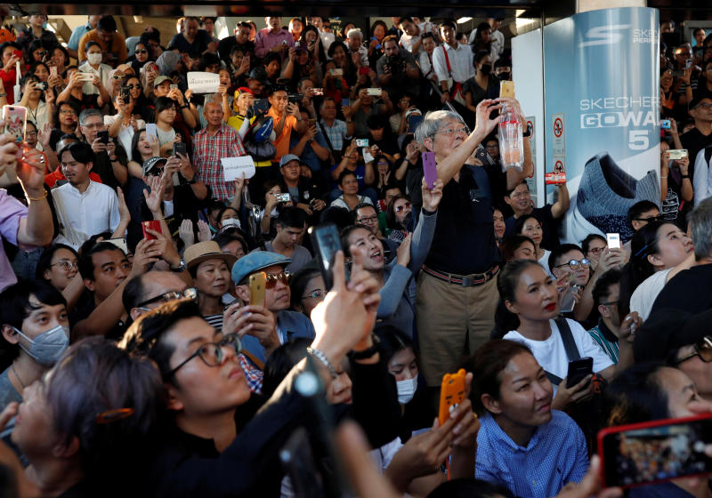 Supporters record with their phones at a sudden unauthorised rally by the progressive Future Forward Party in Bangkok on Saturday. (Reuters photo)