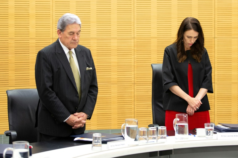 New Zealand Prime Minister Jacinda Ardern leads a minute's silence to remember the volcano victims.