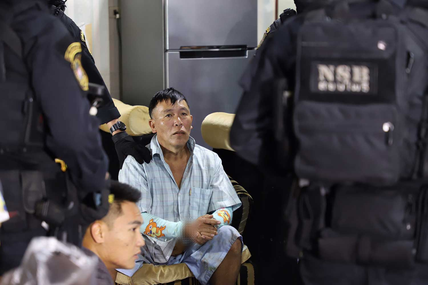 Somsak Sakhonkhiri, 48, a former assistant chief of Nong Phai village in Fang district, Chiang Mai, is arrested during raids on 22 locations targeting drug suspects in Chiang Mai and Chiang Rai on Thursday. (Police photo)