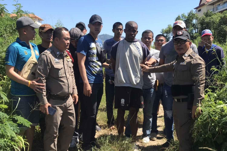 Police arrest Dolcide Shilon, 28, in a grove in tambon Rawai of Muang district, Phuket, on Thursday. (Photo by Achadtaya Chuenniran)