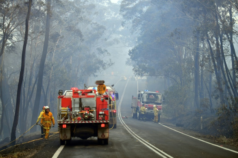 Firefighters die as Australia fires rage, PM cuts short holiday