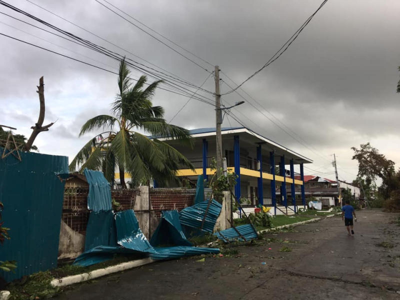 A man walks past damaged homes after Typhoon Phanfone swept through Tanauan, Leyte, in the Philippines on Dec 25, 2019, in this photo obtained from social media. (Paul Cinco/via REUTERS)