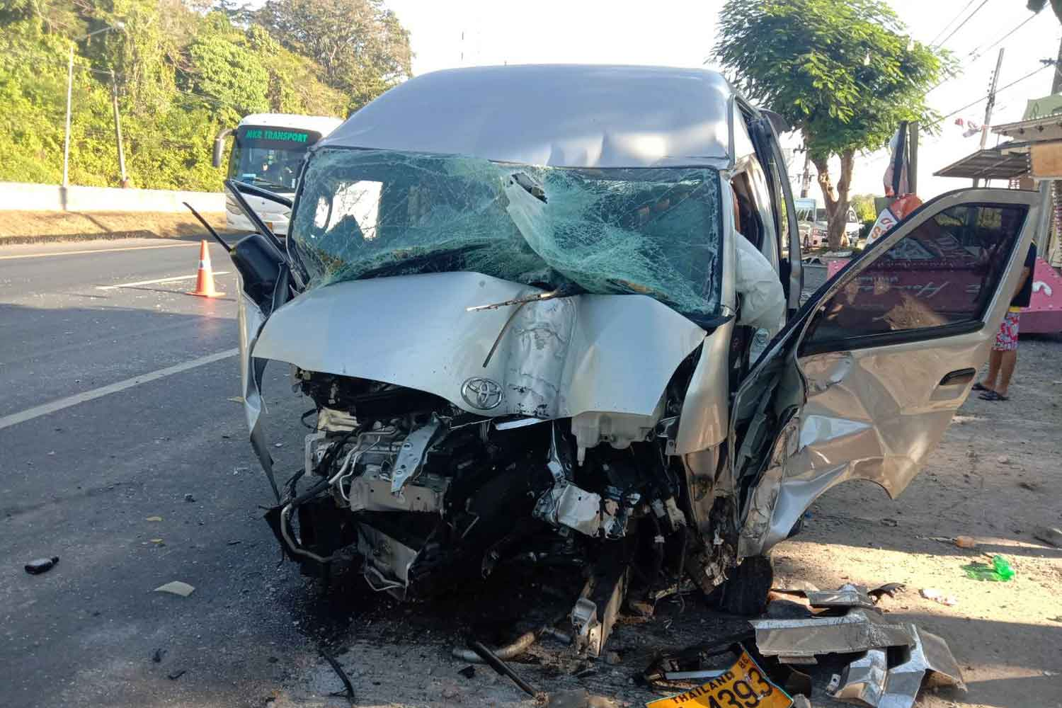 The wreackage of a van after it hit two roadside power poles on its way from Phuket airport to a local hotel in Phuket province on Monday morning. Its 23-year-old driver was seriously injured and believed to have dozed off. Three of five Chinese tourists he picked up were slightly hurt in the crash. (Photo by Achadtaya Chuennirun)
