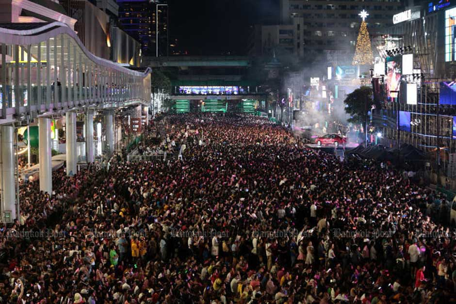 A huge crowd of people packs Ratchadamri Road in Bangkok for a New Year countdown event. — Chanat Katanyu