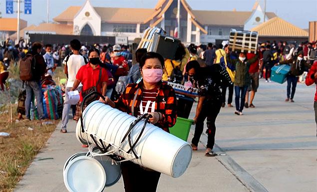 Thailand shutdown triggers migrant exodus into Myanmar