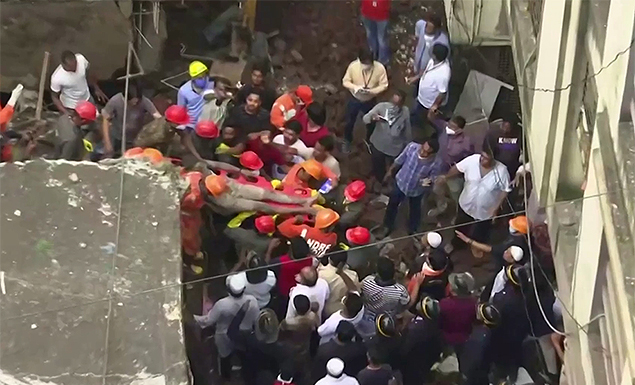 India building collapse death toll climbs to 20