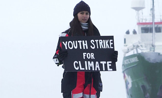 Climate activist stages protest on Arctic ice floe