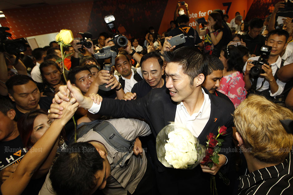 Jan 21: Leader Thanathorn Juangroongruangkit and supporters celebrate after the Constitutional Court acquitted the Future Forward Party of attempting to overthrow the constitutional monarchy. — Wichan Charoenkiatpakul