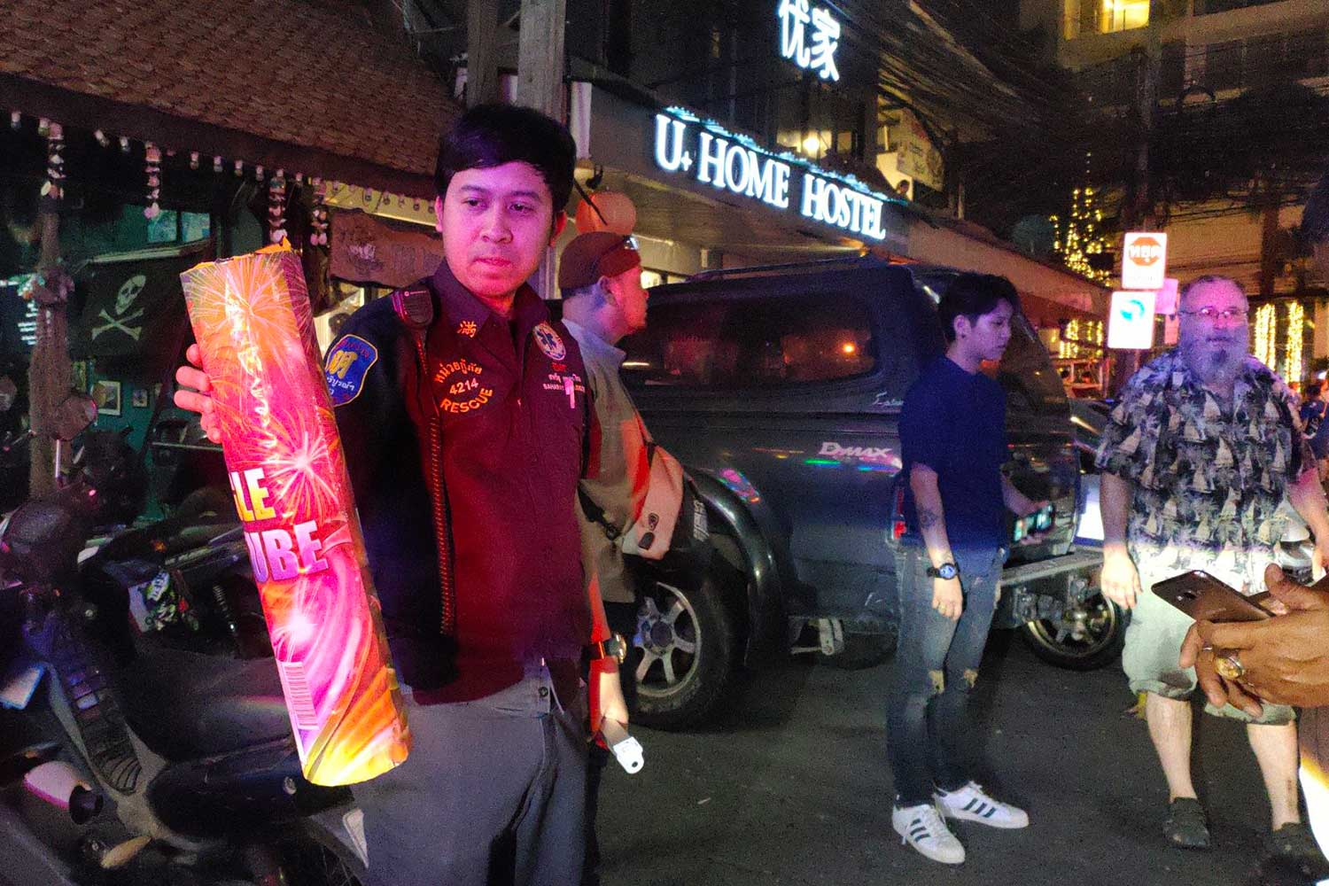 A rescue volunteer shows a firework found on the ground following an explosion that killed a 51-year-old British man in Pattaya, Chon Buri during New Year's celebrations. (Photo by Chaiyot Pupattanapong)