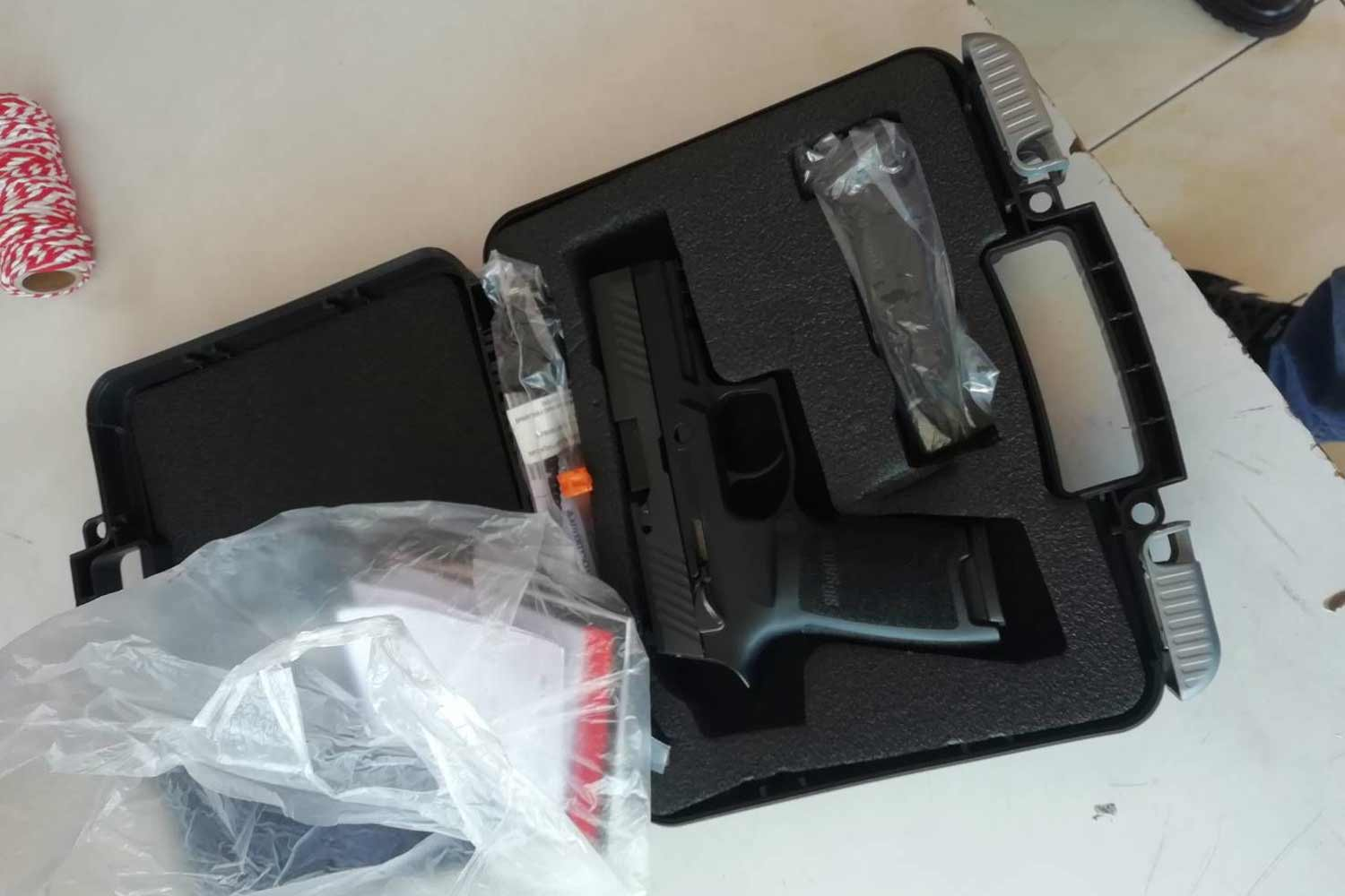 The pistol is kept in its case after a pupil played with it and accidentally shot a friend at Sukhanaree School in Muang district, Nakhon Ratchasima, on Friday morning. (Photo by Prasit Tangprasert)