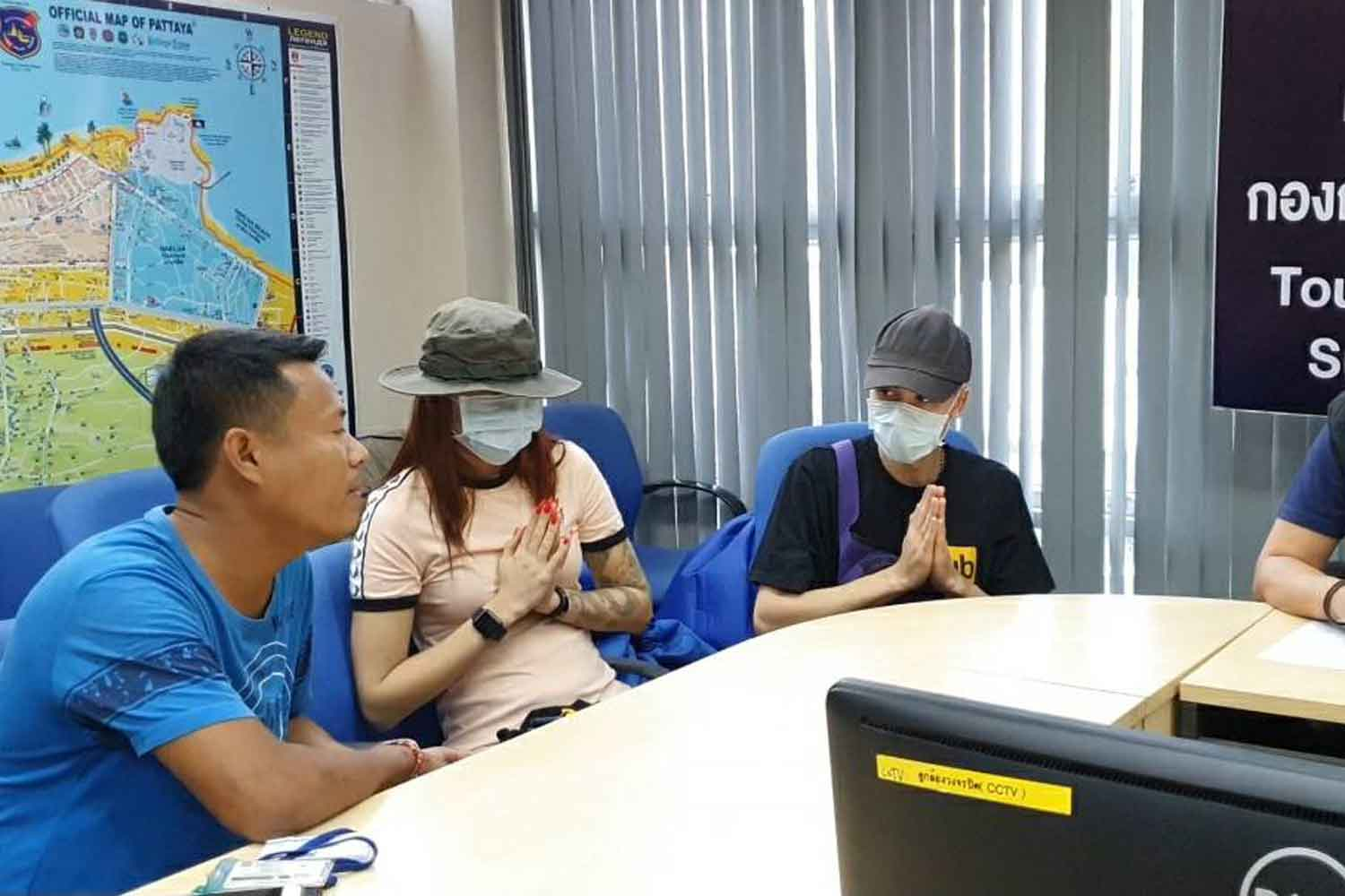 Roman Grigorenko, 26, right, and his partner Daria Vinogradova, 19, apologise for having sex on Pattaya beach, at the Pattaya police station in Pattaya City on Saturday evening. (Police photo)