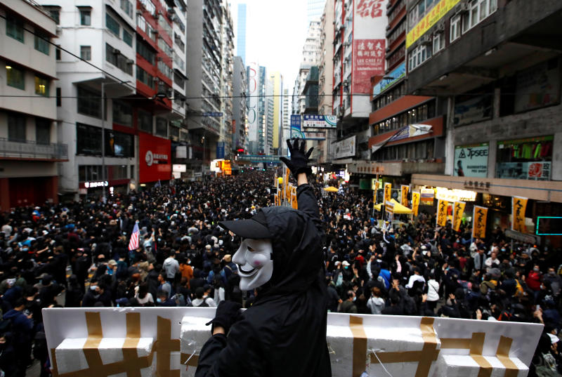 FILE PHOTO: An anti-government protester wearing a Guy Fawkes mask takes part in a demonstration during New Year's Day to call for better governance and democratic reforms in Hong Kong, China, Jan 1, 2020. (Reuters)