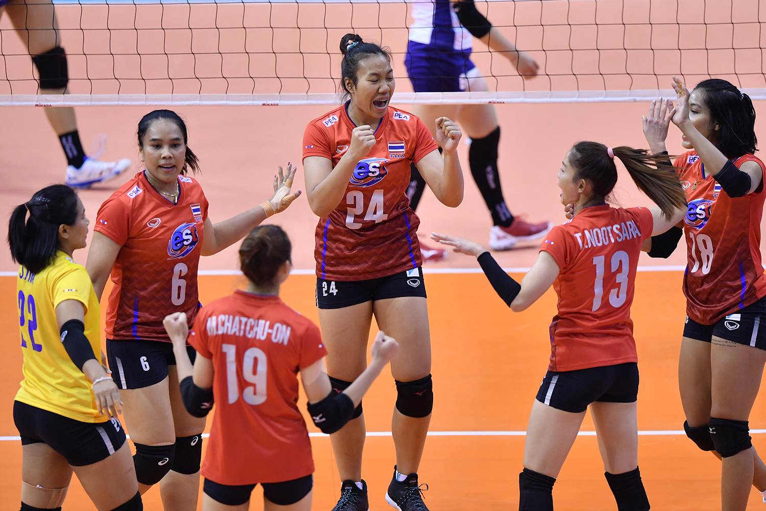Thai players celebrate after a win over Taiwan.