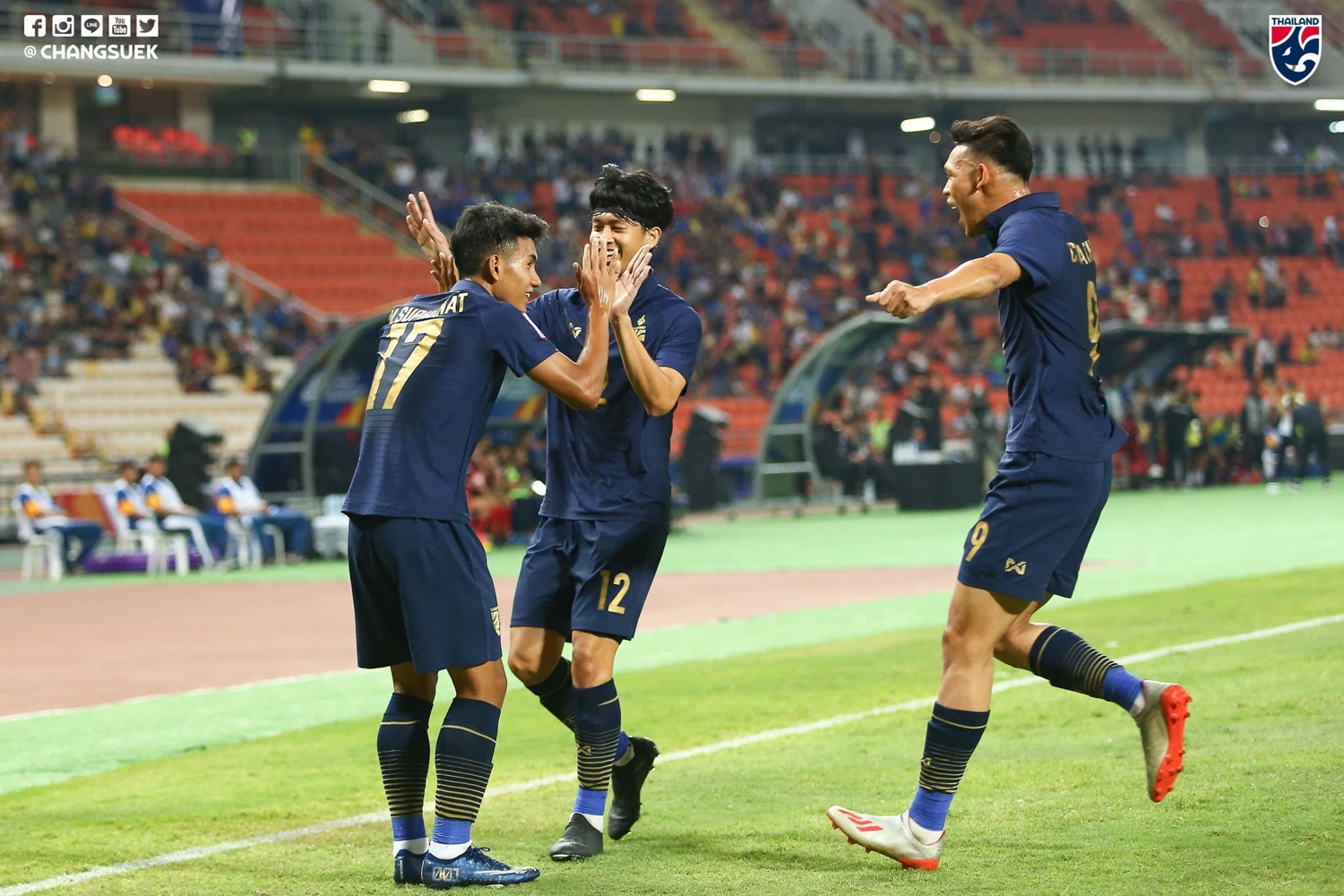 Thai players celebrate after beating Bahrain 5-0 in their opening match at the Thammasat Stadium in Rangsit on Wednesday. (Football Association of Thailand photo)