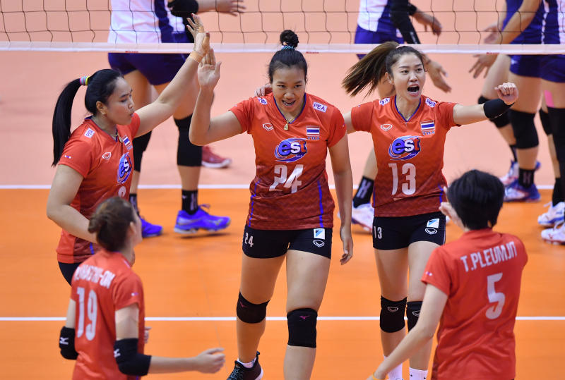 Thai players celebrate after beating Taiwan in the opener of the Asian Olympic qualification campaign in Nakhon Ratchasima on Tuesday. (FIVB photo)
