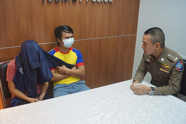Muan Sophan, left, and his wife, Thippapha Thonnasri, during questioning by police. (Photo by Sutthiwit Chaiyuworakan)