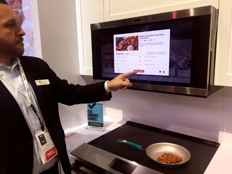 Jeremy Miller of GE Appliances shows a smart hub which uses artificial intelligence to help with meal planning and preparation, at the 2020 Consumer Electronics Show in Las Vegas
