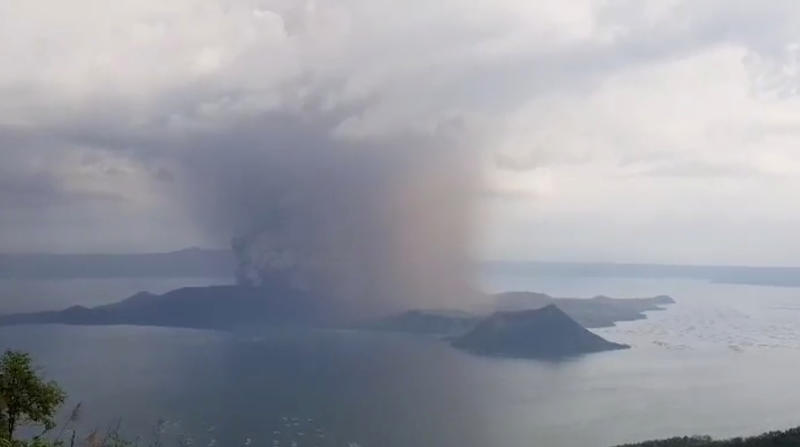 A view of the Taal volcano eruption seen from Tagaytay, Philippines on Sunday in this still image taken from social media video. (Jon Patrick Laurence Yen via REUTERS)