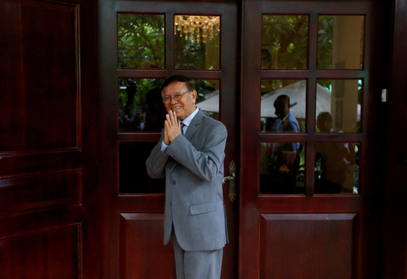 Cambodian opposition leader Kem Sokha greets media at his home in Phnom Penh on Nov 13, 2019. (Reuters photo)