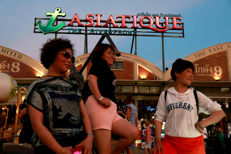 Tourists pose for a photo at Asiatique night market in Bangkok, April 23, 2019. (Reuters file photo