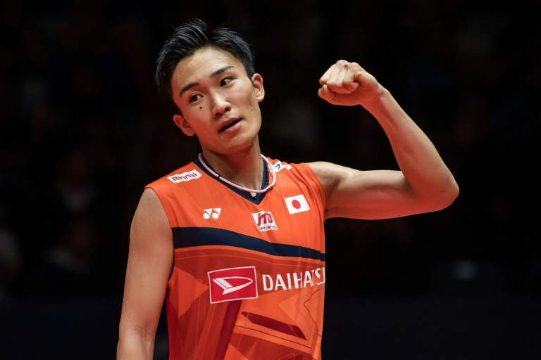 Flying home: World number one Kento Momota was discharged from a Malaysian hospital on Wednesday.