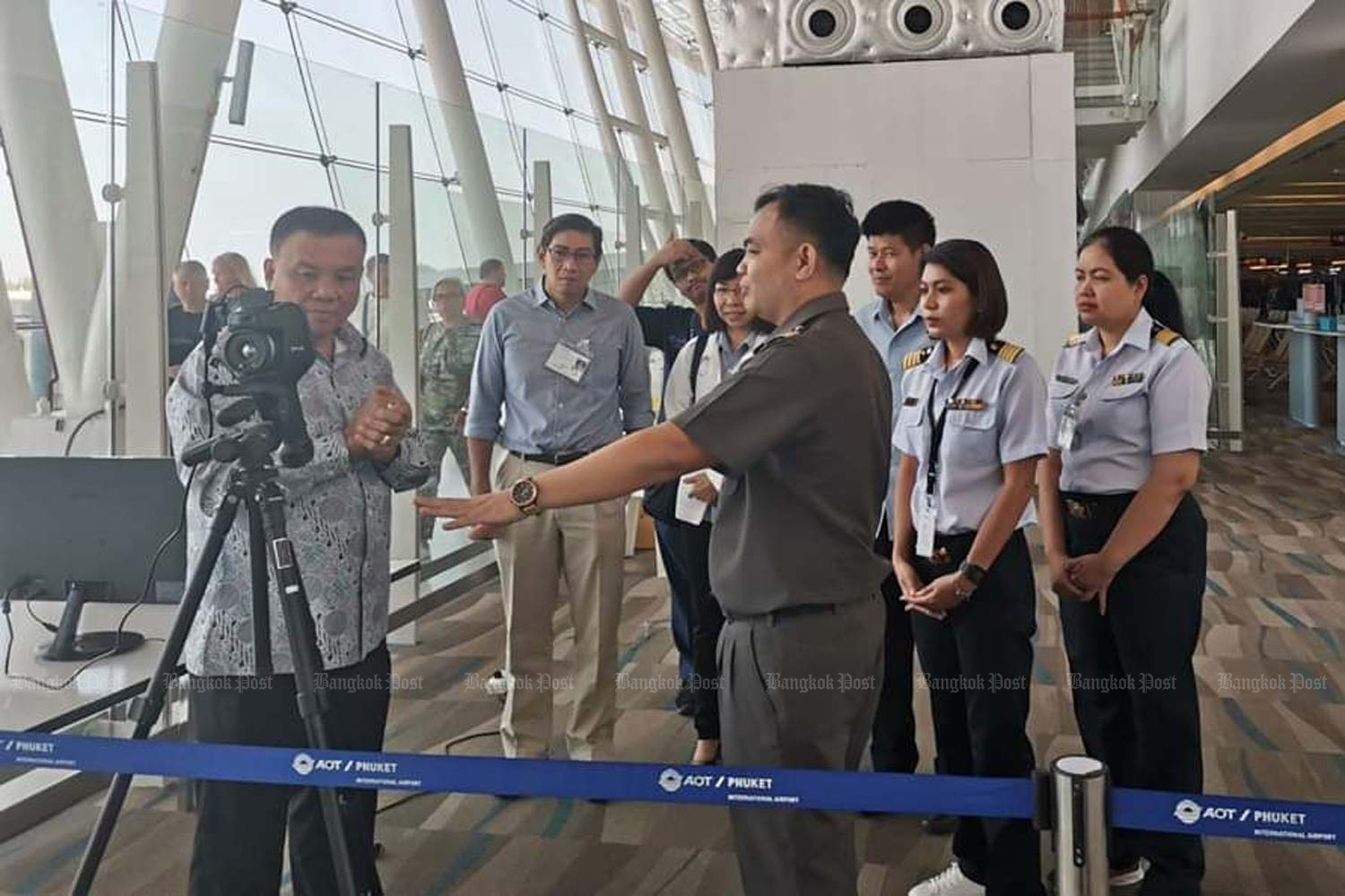 Public Health officials screen people arriving at Phuket and other international airports from Wuhan. (Photo by Achadtaya Chuenniran)