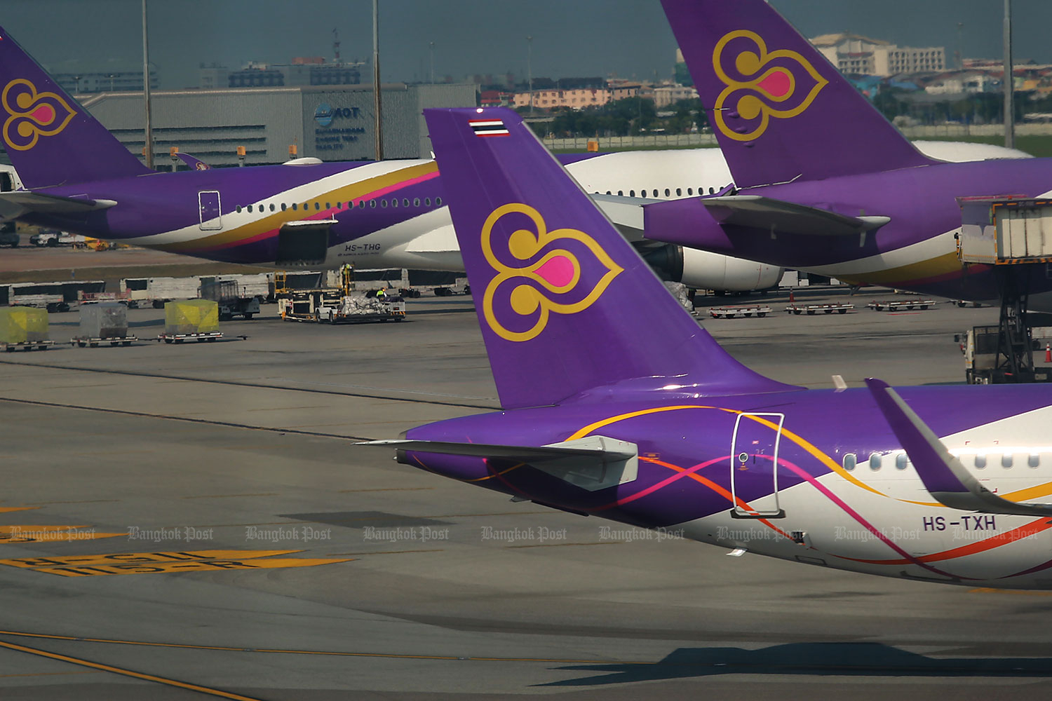 THAI jets are stationed at Suvarnabhumi airport. The nation's aviation sector slumped last year in the stock market, as share prices declined. (Photo by Somchai Poomlard)