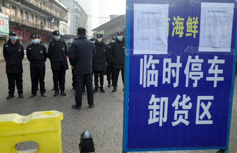 Wuhan steps up checks, warns of more virus cases