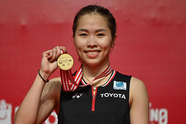 Ratchanok Intanon poses with her gold medal after defeating Carolina Marin of Spain in the women's singles final match at the Indonesia Masters tournament in Jakarta on Sunday. (AFP photo)