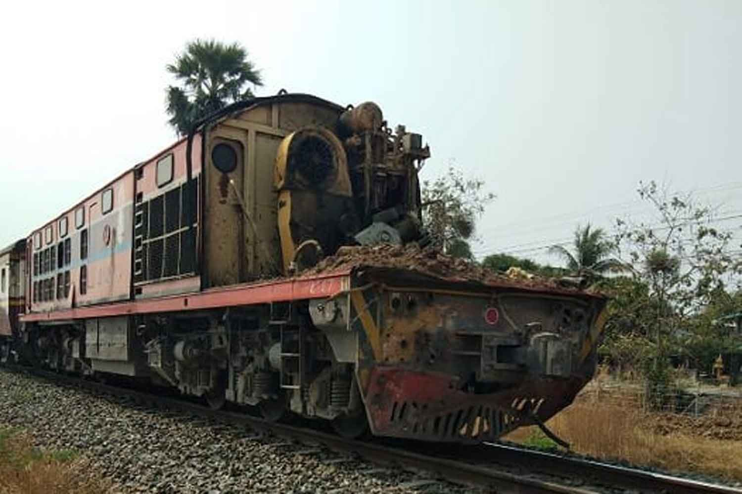 The front of this locomotive pulling a Bangkok-Denchai train was torn off when it hit a trailer truck on a railway crossing in Nakhon Sawan on Monday. The train driver suffered a head wound and the engineer minor injuries. The truck driver escaped serious hurt. (Photo: Chalit Poomruang)