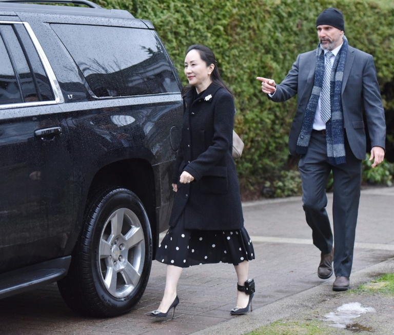 Huawei chief financial officer Meng Wanzhou leaves her Vancouver home to begin her extradition hearing in British Columbia Supreme Court, on January 20, 2020 in Vancouver, British Colombia.