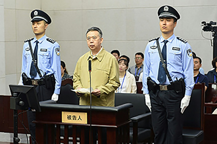 China's former Interpol chief jailed for 13 years