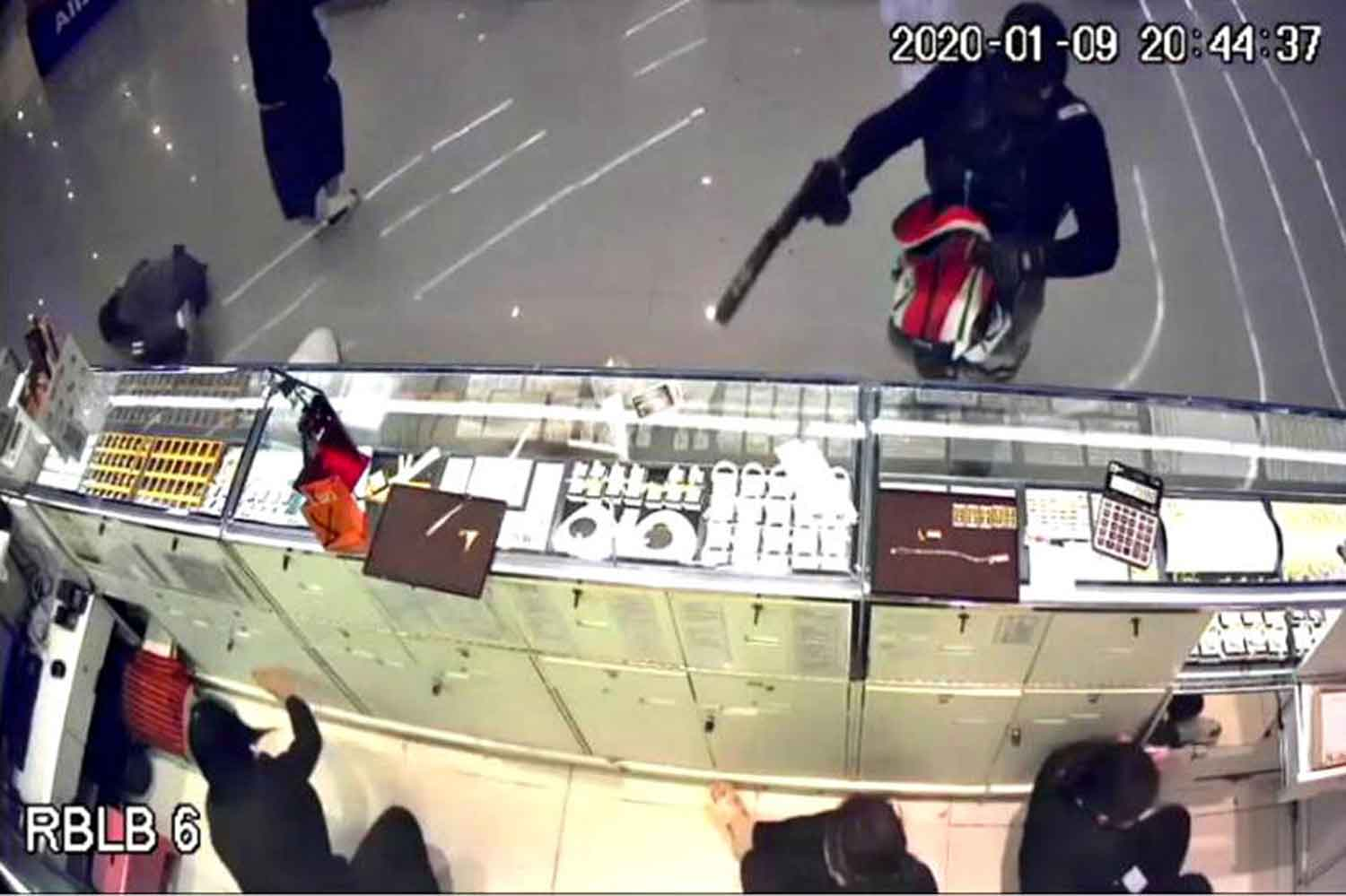 Surveillance camera footage shows the robber at the counter of the Aurora gold shop in Robinson department store in Muang district, Lop Buri, on the night of Jan 9.