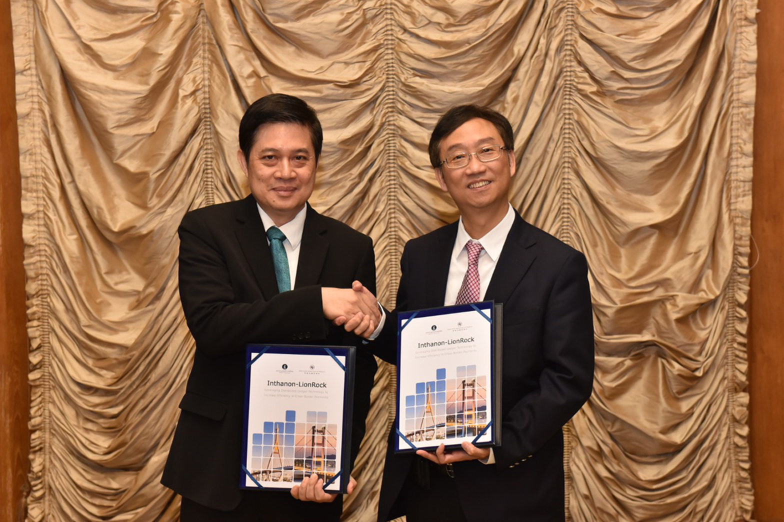 Edmond Lau, senior executive director of the Hong Kong Monetary Authority (right), and  Mathee Supapongse, deputy Bank of Thailand governor, announce the publication of the joint research report on the application of Central Bank Digital Currency to cross-border payments on Wednesday in Hong Kong. (Hong Kong Monetary Authority photo)
