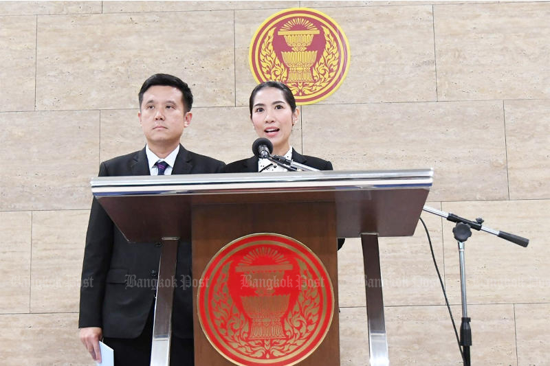 Prim Pooncharoen of the Palang Pracharath Party speaks as her party colleague, Chaiwut Thanakhamanusorn, looks on in a press conference in Parliament on Thursday defending the former's vote more than once during the budget debate session.
