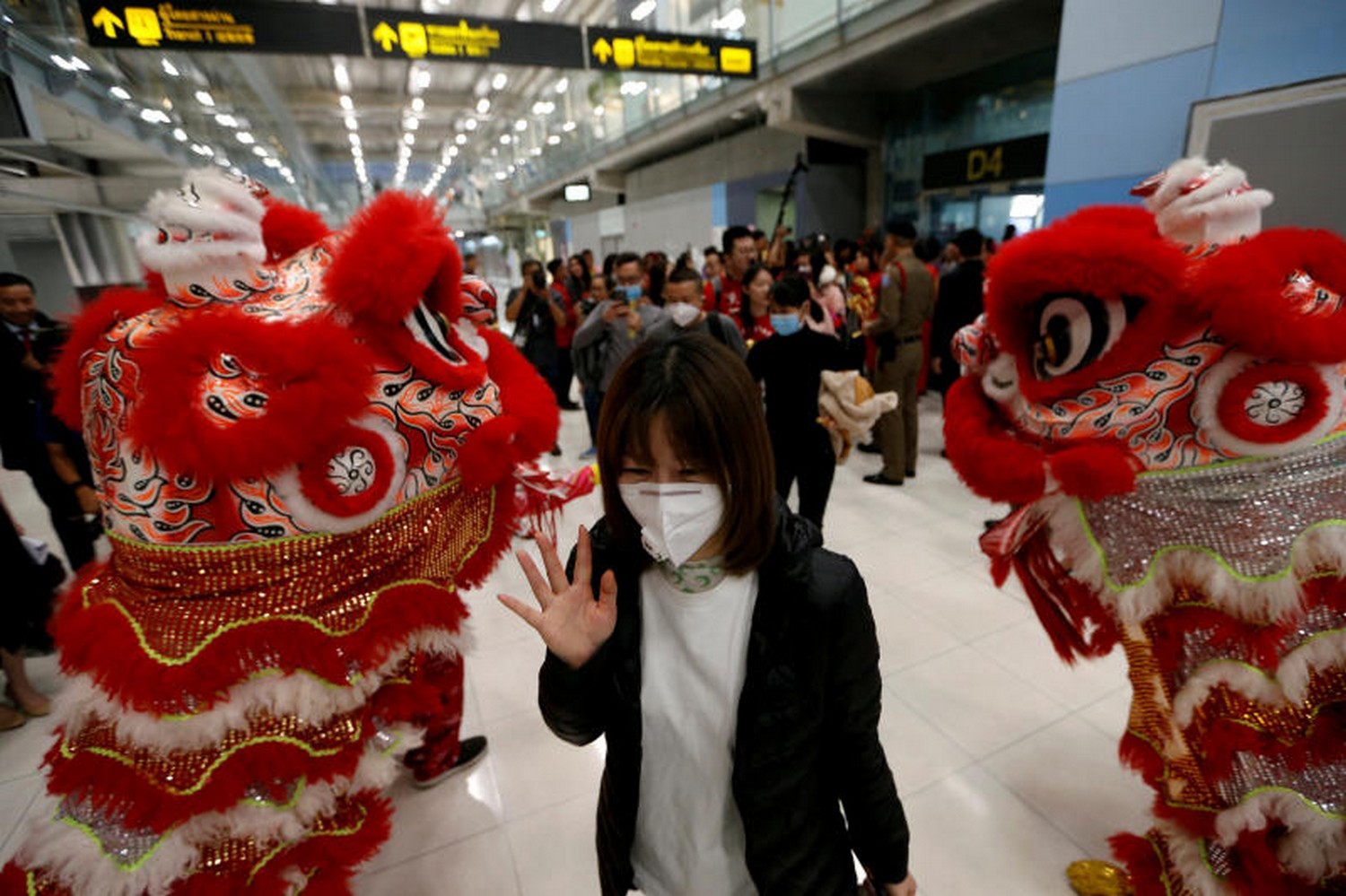 A Chinese tourist wears a mask as she arrives at Suvarnabhumi airport on Wednesday, ahead of the  Lunar New Year celebration in Bangkok. (Reuters photo)